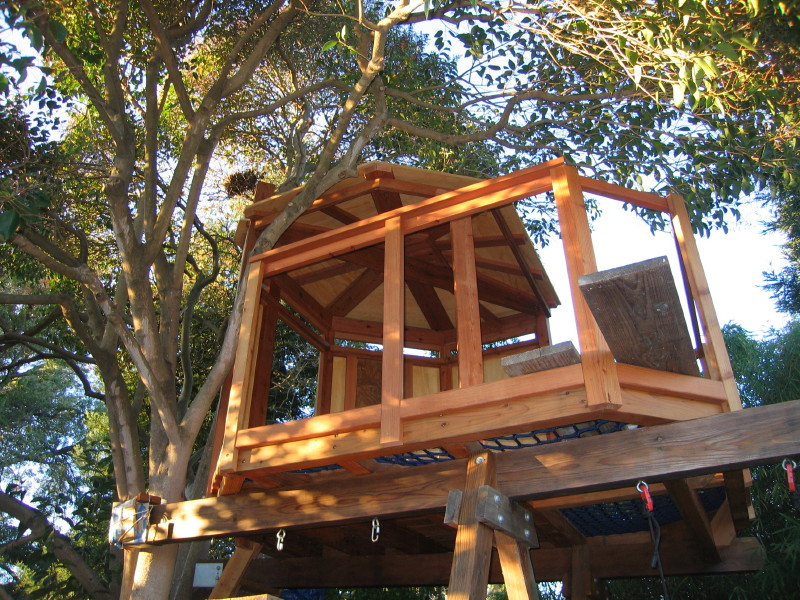 wide view of Treehouse Yurt - This beautiful all custom redwood trimmed craftsman treehouse aka 'The Tree Yurt' was designed with one side open and with half the floor / deck area made of strong walkable netting. The treehouse sits on two 9 foot tall A-frame