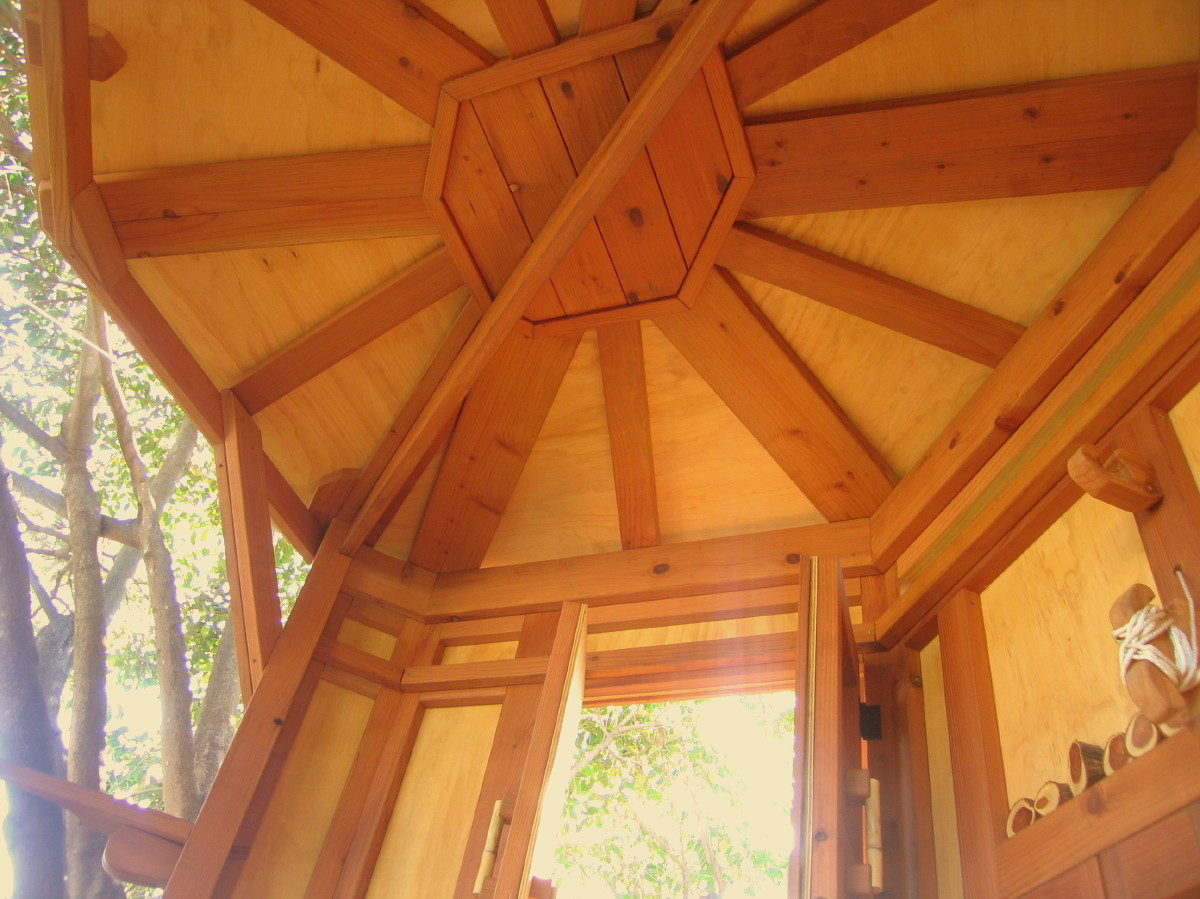 Hexagonal yurt-shaped ceiling / roof with careful workmaship, clear heart redwood throughout, low VOC AC plywood ceilings and walls, sealed. All corners sanded smooth, no splinters, expensive but worth it.