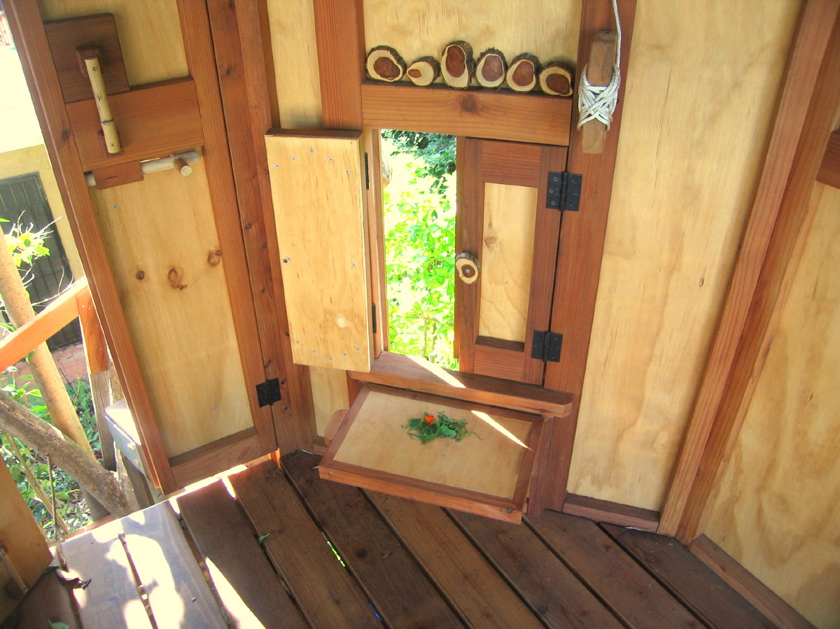 Tree Yurt treehouse, note: the custom wooden slide bolt for door latching