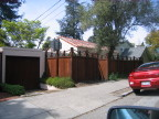 redwood fence with unusual trellis